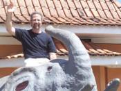John Mundell on an elephant statue in Brazil